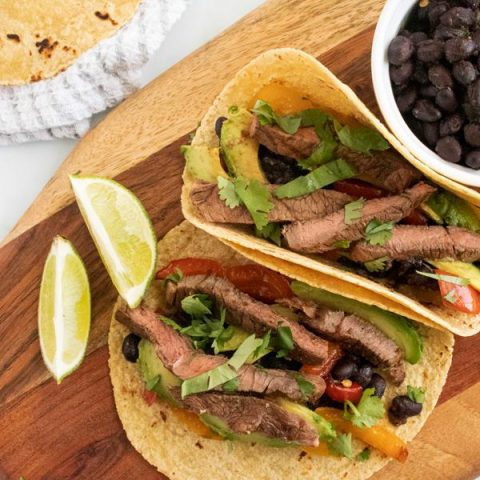 Grilled steak tacos with green chile black beans and grilled tortillas
