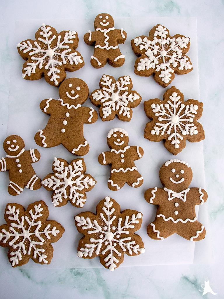 Gingerbread cookies decorated with royal icing and sprinkles