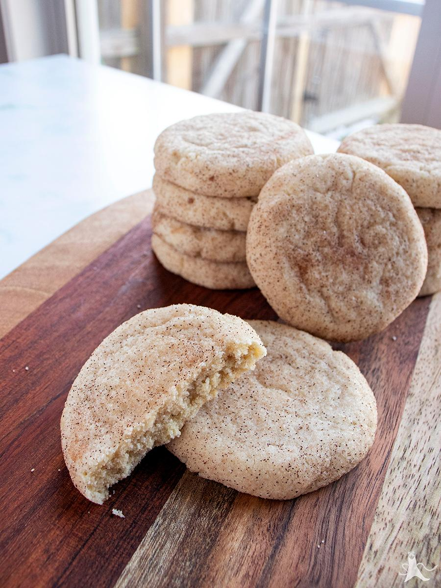 Dairy free Snickerdoodle cookies with one broken in half
