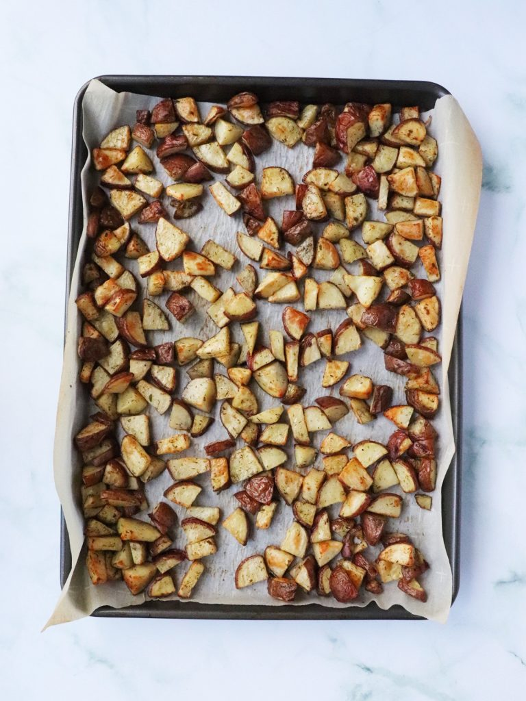 roasted red potatoes on a baking sheet